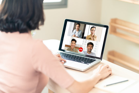 Asian business woman talking to colleague team about plan in video conference. Group of multiethnic business people using computer for online meeting in video call conference. Smart working from home.