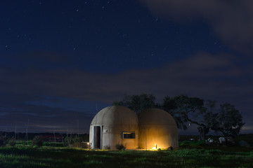 Night photography of round houses similar to the star wars of Ceclavin in Extremadura