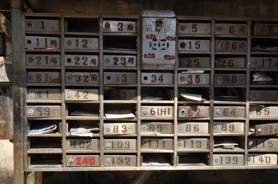 Sunlight Falling On Old Mail Boxes