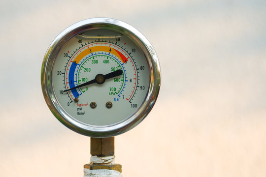 Close up water pressure gauge on natural blur background, Free copy space. clipping path.