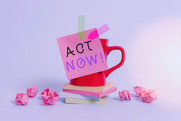 Conceptual hand writing showing Act Now. Concept meaning do not hesitate and start working or doing stuff right away Coffee cup sticky note banners paper balls pastel background