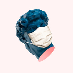 Blue statue head in protective face mask. Quarantine. Negative space to insert your text. Modern...