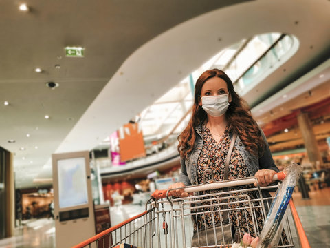 Woman with medical mask inside of a shopping mall