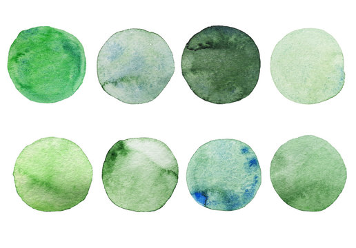 Set of green watercolor dots. Hand painted Spots on a white background. Round, circle. Isolated. Blobs of different color