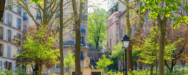 Paris, Montmartre, typical street with a vintage lamppost, beautiful buildings and staircase