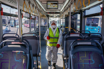 A worker of Istanbul Metropolitan Municipality disinfects the local buses to prevent the spread of the COVID-19, the novel coronavirus.