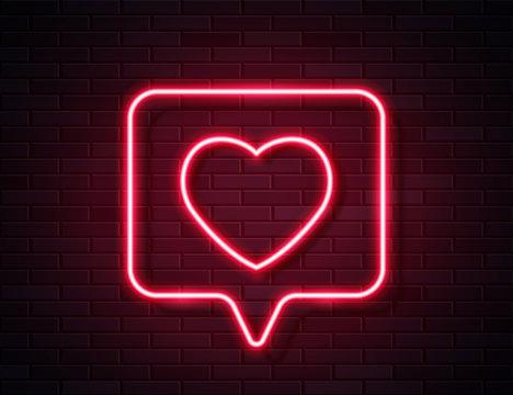 Neon Red Glowing Heart in Spech Bubble Banner on Dark Empty Grunge Brick Background.