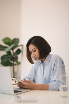 Attractive young businesswoman sitting alone at a desk