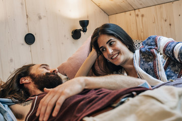Good-Looking Caucasian Couple Talking in Bed