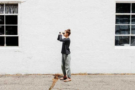 Preteen girl looking through binoculars