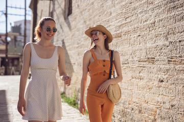 Two Friends Having Fun In A Beautiful Town