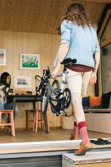 Faceless Hipster Carrying Folding Bike