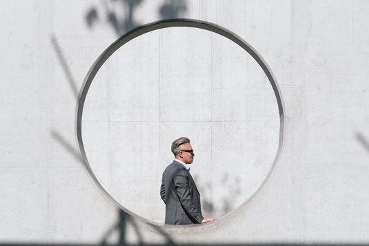 Portrait of mature businessman standing outdoors