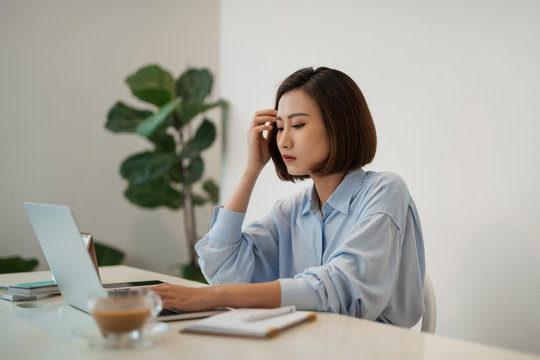 Young businesswoman is having problems with project in office.
