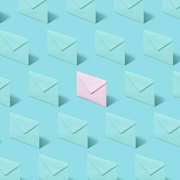 Envelope pattern on a pastel background .