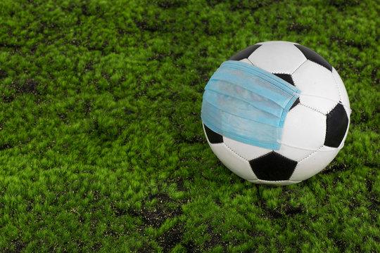 soccer ball in coronavirus mask