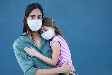 Mother and daughter with a face mask