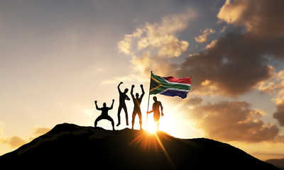 A group of people celebrate on a mountain top with South Africa flag. 3D Render