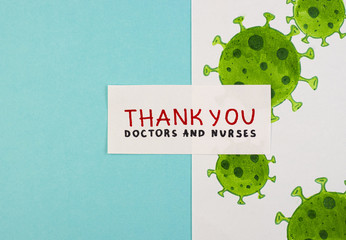 picture of the virus and the inscription Thank you to doctors and nurses on a blue background