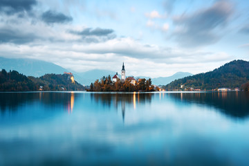 Evening autumn view of Bled lake in Julian Alps, Slovenia. Pilgrimage church of the Assumption of Maria on a foreground. Landscape photography