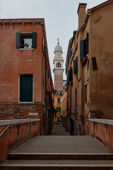 Venice Italy, February 17 2020. Walking on streets of Venice and in the background the catholic church Parrocchia di San Pantalon