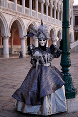 Venice Italy, February 19 2020. Woman in costume and mask photographed at St. Mark's Square in Venice Carnival.