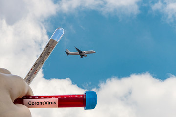 airplane flying in the sky and CoronaVirus ,  restrictions for travels
