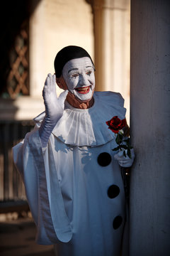 Venice Italy, February 18 2020. Man in decorated mask posing to photographers and salute crowd at St Mark's Square during Venice Carnival (Carnivale di Venezia