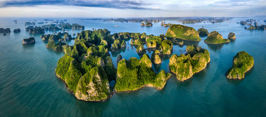 Aerial view Vung Vieng floating fishing village and rock island, Halong Bay, Vietnam, Southeast Asia. UNESCO World Heritage Site. Junk boat cruise to Ha Long Bay. Famous destination of Vietnam Fototapete