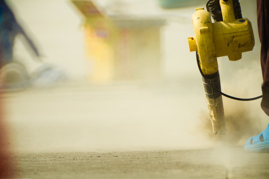 The worker use blower cleaning construction concrete pavement joint, before sealing asphaltic.