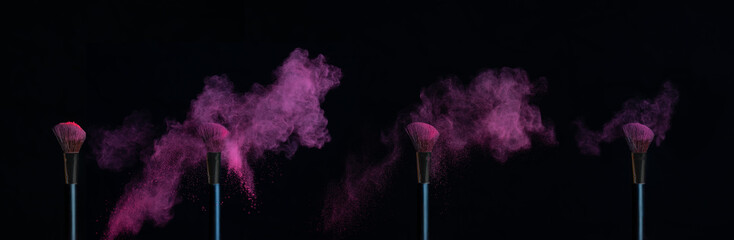 Four make-up brushes with sequence of pink powder explosions on black background
