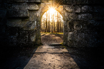 ancient archway with sun in the center