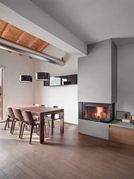 interiros of a modern dining room with fireplace