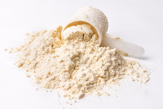 heap of protein powder on white
