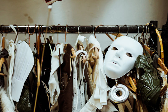 Mask With Costumes Hanging On Rack