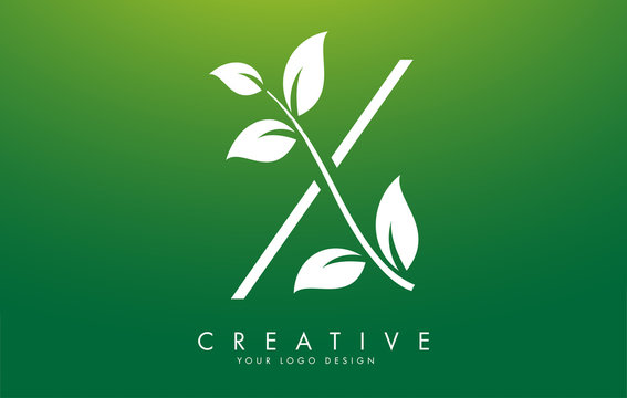 White Leaf Letter X Logo Design with Leaves on a Branch and Green Background. Letter X with nature concept.
