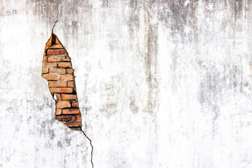 Old shabby white concrete and brick wall cracks. Cracked white cement wall. Old masonry stone...