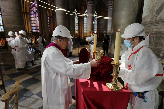 Paris Archbishop Michel Aupetit venerates the holy crown of thorns in the heart of Notre-Dame cathedral in Paris