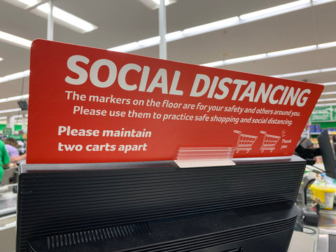 Social Distancing Sign at a Checkout Station in a Grocery Store