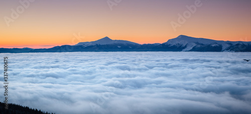 Wall mural Incredible air view of the valley with dense fog. Location Carpathian mountain, Ukraine, Europe.