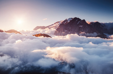 Wall Mural - Thick fog covered the ridge in morning. Location place Val di Fassa valley, Dolomites, Italy.