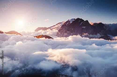 Wall mural Thick fog covered the ridge in morning. Location place Val di Fassa valley, Dolomites, Italy.