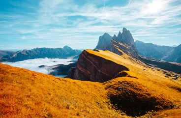 Fotomurales - Morning view of the alpine valley in sunlight. Location place Puez-Geisler National Park, Seceda peak, Italy.