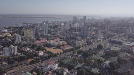 Wall Mural - Aerial view of Maputo downtown with highrises, bay and Golden Bridge, the capital city of Mozambique
