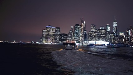 Wall Mural - Ferry crossing Brooklyn to Manhattan at night, New York City. Slow motion scene