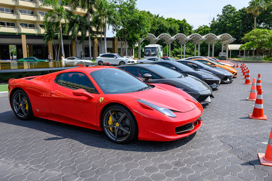 Colorful sport cars of variety of famous brands parking on front of the Royal Cliff Beach Hotel