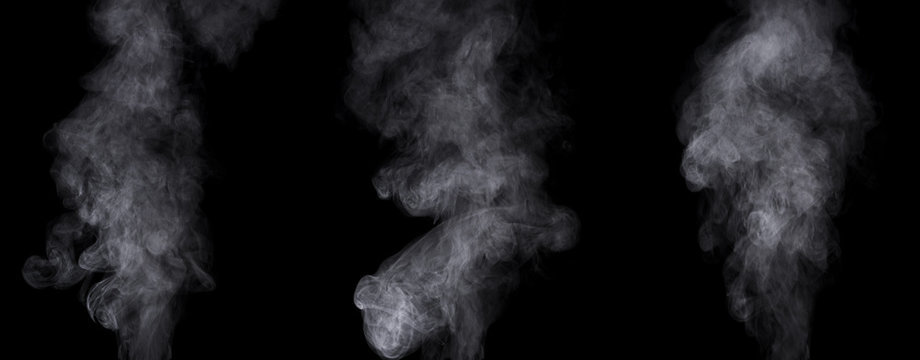 Set of different steam clouds against black background.