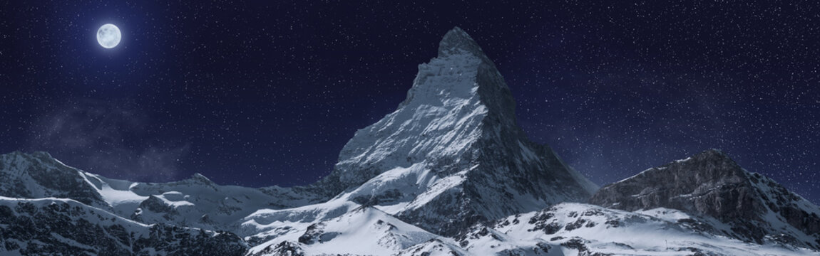 panoramic view to the majestic Matterhorn mountain at night. Valais, Switzerland