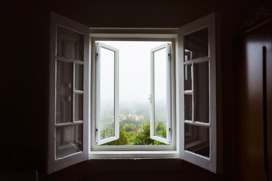 Wide open window with amazing countryside view on foggy day. Stay home concept. Scenery view from the house. Travel to Spain and holidays concept. Open a window to air the room. Ventilate your house.