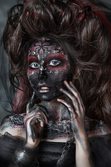 Fotobehang Schilderkunstige Inspiratie close up portrait of terribly beautiful girl with Halloween skull makeup. Black face painting. lush hair